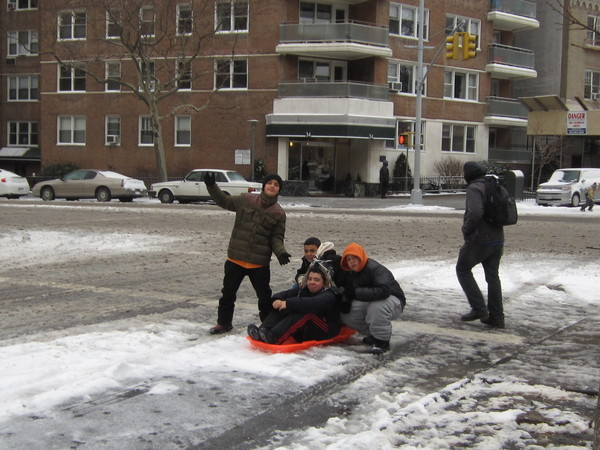 Sledding in Grand Army Plaza - Prospect Heights